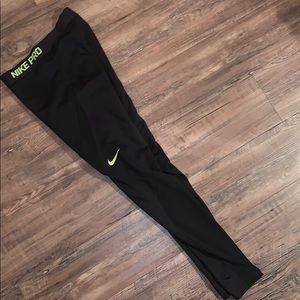 black and neon green NIKE pro leggings